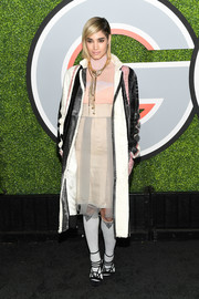 Sofia Boutella topped off her dress with a tricolor fur coat, also by Prada.