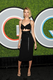 Hailey Clauson looked glam in a black Michael Kors dress with spaghetti straps and a midriff cutout at the 2017 GQ Men of the Year Awards.