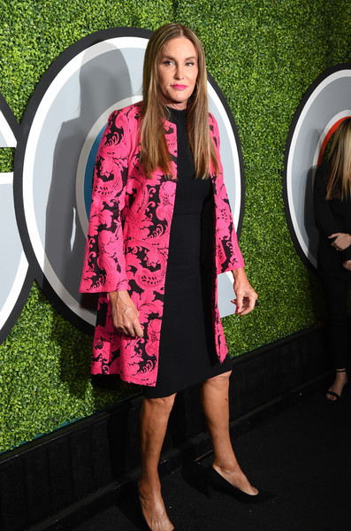 Caitlyn Jenner arrived for the 2017 GQ Men of the Year party wearing a fuchsia print coat over a little black dress.