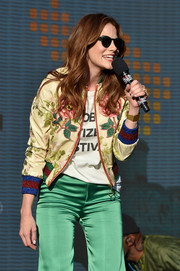 Michelle Monaghan spoke onstage at the 2017 Global Citizen Festival wearing a floral silk bomber jacket by Gucci.