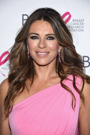 Elizabeth Hurley kept it classic and glam with this feathered flip at the 2017 Hot Pink Party.
