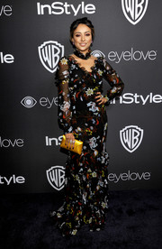 Kat Graham brightened up her look with a yellow satin envelope clutch.