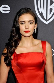Nina Dobrev finished off her look with bright red lipstick that was a perfect match to her dress!