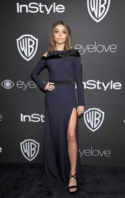 Sarah Hyland was modern and sophisticated at the InStyle and Warner Bros. Golden Globes post-party in a navy Amanda Wakeley gown with a shoulder cutout and a high side slit.