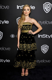 Peyton List kept it classy and feminine at the InStyle and Warner Bros. Golden Globes post-party in a black Carolina Herrera strapless dress featuring a tiered skirt and gold embroidery.
