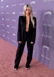 Kim Kardashian was a little more covered up than usual in this vintage Tom Ford for Gucci pantsuit at the 2017 LACMA Art + Film Gala. She made sure to show some cleavage, though, for that signature Kim K sex appeal!