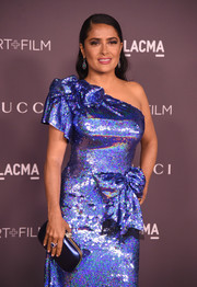 Salma Hayek matched a blue satin clutch with a one-shoulder sequin dress for the 2017 LACMA Art + Film Gala.