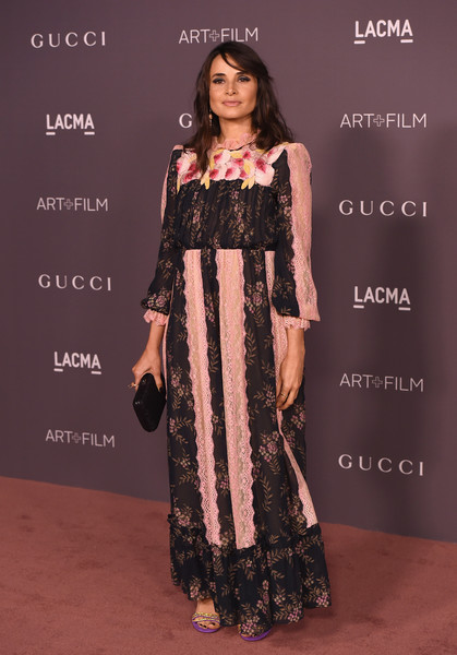 Mia Maestro in a floral gown