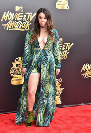 Jillian Rose Reed complemented her dress with green velvet ankle boots by Steve Madden.