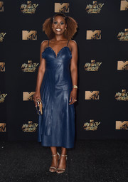 Issa Rae styled her dress with gold Stuart Weitzman Nudist sandals.
