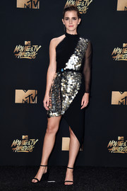 Emma Watson went the contemporary route in a one-sleeve, paillette-embellished dress by KITX when she attended the 2017 MTV Movie and TV Awards.