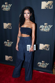 Jhene Aiko teamed her top with wide-leg pinstriped pants, also by DKNY.