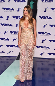 Heidi Klum sent temperatures soaring with this cleavage-flaunting sheer gown by Dundas at the 2017 MTV VMAs.