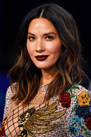 Olivia Munn went bold and edgy with this dark shade of red on her lips.