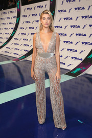 Hailey Baldwin mesmerized in a sheer, beaded silver jumpsuit by Zuhair Murad Couture at the 2017 MTV VMAs.