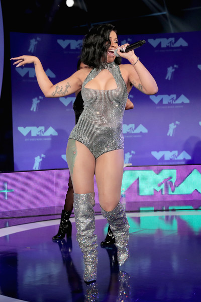Cardi B amped up the sparkle with a pair of silver over-the-knee boots.