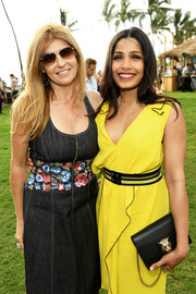 Freida Pinto paired a black chain-strap bag with a yellow dress for day 1 of the 2017 Maui Film Festival.