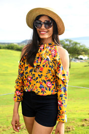 Freida Pinto accessorized with a pair of patterned shades for extra sun protection.