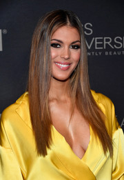 Iris Mittenaere wore her hair in sleek straight layers at the 2017 Miss Universe Pageant.