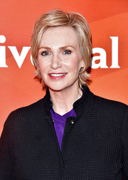 Jane Lynch styled her hair into a layered razor cut for the 2017 NBCUniversal Summer Press Day.
