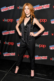 Katherine McNamara donned a black tie-neck jumpsuit for day 3 of New York Comic Con 2017.