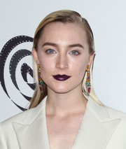 For her beauty look, Saoirse Ronan went bold with a dark plum lip.