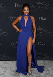 Bethany Mota displayed plenty of leg in a high-slit cobalt halter gown by Jovani at the 2017 Princess Grace Awards Gala.