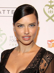 Adriana Lima highlighted her pout with a swipe of gloss.