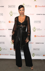 Adriana Lima struck the perfect balance between sultry and edgy with this sheer, studded lace and leather number by Alberta Ferretti at the 2017 St. Luke Foundation for Haiti benefit.