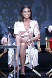 Nathalie Kelley flaunted plenty of leg in a high-slit blush cocktail dress as she sat onstage at the 2017 Summer TCA Tour.