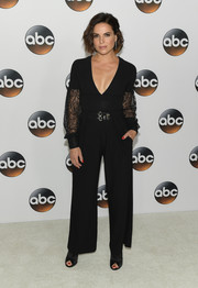 Lana Parrilla worked a plunging black jumpsuit with lace-panel sleeves at the 2017 Summer TCA Tour.
