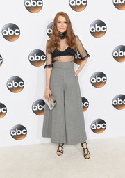 Darby Stanchfield contrasted her revealing top with conservative wide-leg pants.