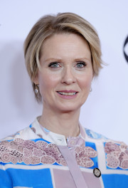 Cynthia Nixon attended the 2017 Tony Awards Meet the Nominees press junket wearing her usual short side-parted style.