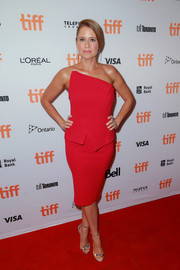 Jenna Fischer slipped into a strapless red dress with an asymmetrical neckline and peplum detailing for the TIFF premiere of 'Brad's Status.'