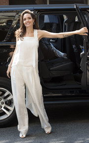 Angelina Jolie matched her top with a pair of white pajama trousers, also by Givenchy.