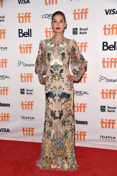 Rosamund Pike oozed glamour wearing this intricately embroidered gown by Alexander McQueen at the TIFF premiere of 'Hostiles.'