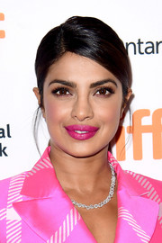 Priyanka Chopra looked simply stylish with her slicked-down ponytail at the TIFF premiere of 'Pahuna: The Little Visitors.'