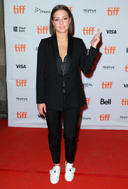 Adele Exarchopoulos teamed a black suit with a lacy corset top for the TIFF premiere of 'Racer and the Jailbird.'