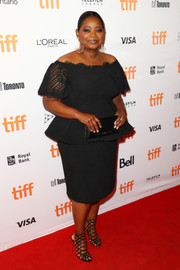 Octavia Spencer styled her LBD with a pair of cage sandals by Schutz.