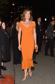 Allison Janney styled her outfit with a gold box clutch by Sophia Webster.