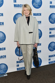 Martha Stewart completed her monochromatic outfit with a pair of beige slacks.