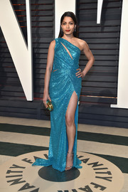 Freida Pinto looked totally dazzling in a slashed blue sequin gown by Elie Saab at the Vanity Fair Oscar party.