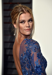 Nina Agdal was sexily coiffed with this messy updo at the Vanity Fair Oscar party.
