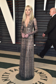 Portia Doubleday was all about tough elegance in a studded nude gown by Naeem Khan at the Vanity Fair Oscar party.