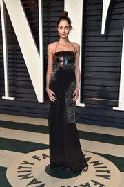Nicole Trunfio sheathed her supermodel figure in a shimmering sequin gown by Escada for the Vanity Fair Oscar party.