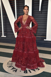 Tracee Ellis Ross hit the Vanity Fair Oscar party wearing this showstopper of a gown by Zuhair Murad Couture, featuring intricate red beading, a plunging neckline, and bell sleeves.