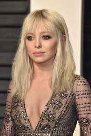 Portia Doubleday rocked a teased platinum-blonde hairstyle with choppy bangs at the Vanity Fair Oscar party.