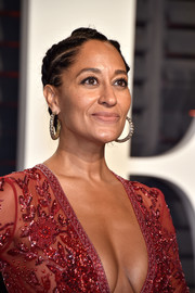 Tracee Ellis Ross looked playfully glam with her cornrow updo at the Vanity Fair Oscar party.