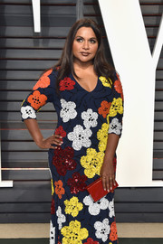 Mindy Kaling's red Edie Parker box clutch and multicolored floral dress at the Vanity Fair Oscar party were a gorgeous pairing!