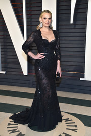 Molly Sims made an alluring statement in a sheer black gown by Tony Ward at the Vanity Fair Oscar party.